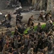 Hombres, Elfos y Orcos luchando