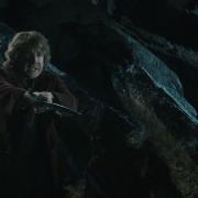 Bilbo desconfía de Gollum
